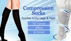 TWO pairs of compression socks,